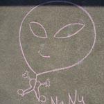 Why does rain dissolve a sidewalk chalk drawing?