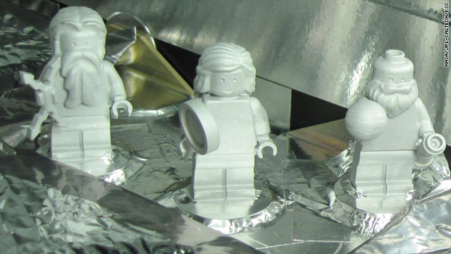 LEGO mini-statues of the mythological god Jupiter, left, his wife Juno, and the astronomer Galileo will be aboard the Mission Juno satellite.