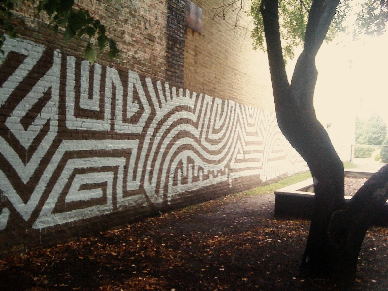 I like how the curves of Mental312's graffiti mimics the curve of the tree