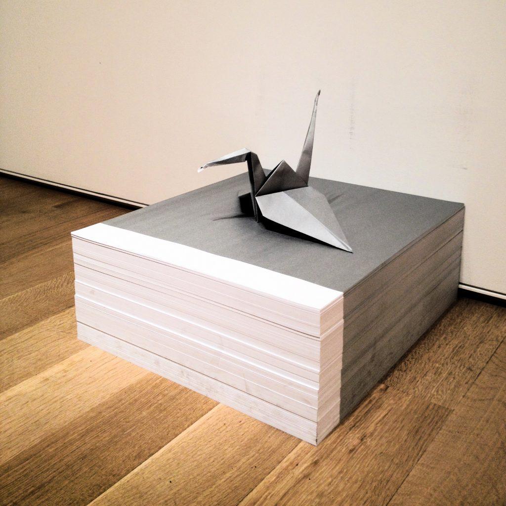 """""""Origami crane atop paper stack"""" collaboration Félix González-"""