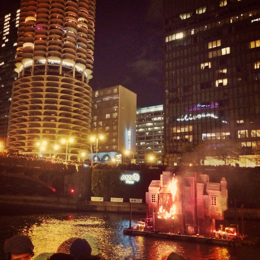 The third house finally starts to burn on the Chicago River at the Great Chicago Fire Festival