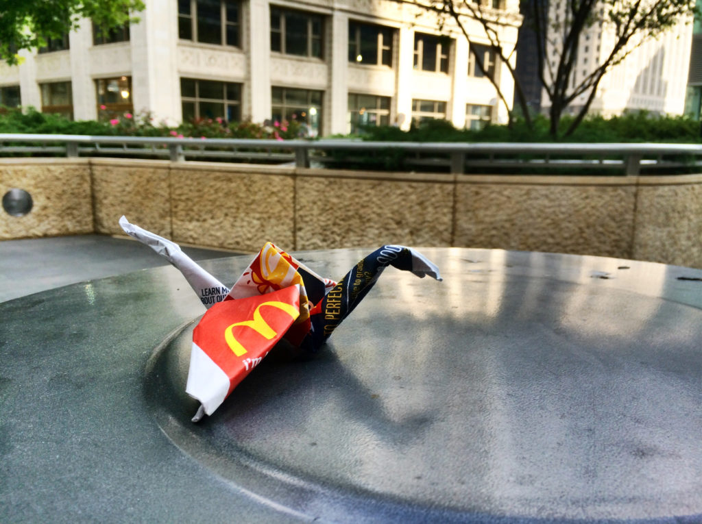 McDonalds bag origami atop garbage can