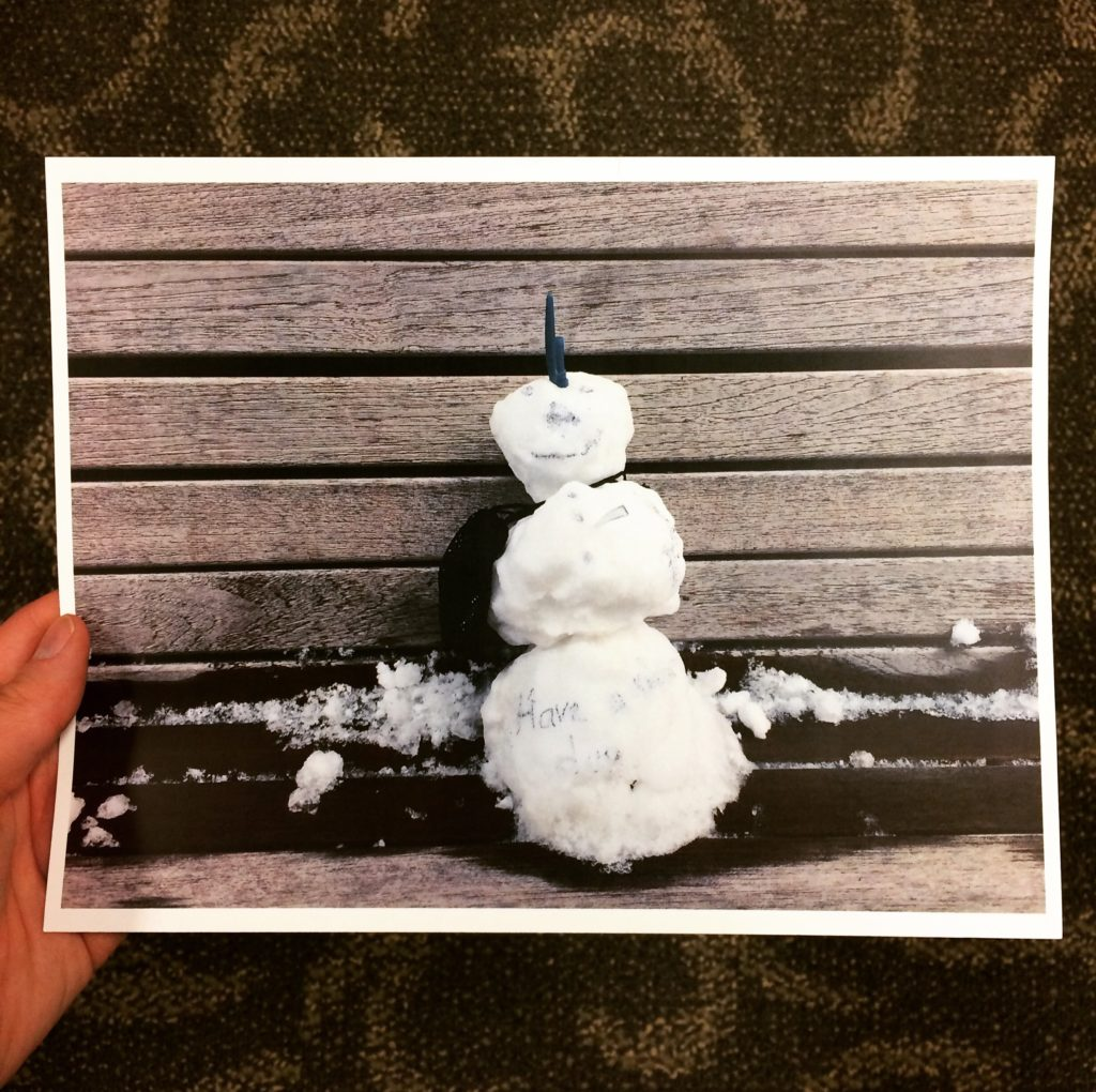 Print of snowman sitting on bench
