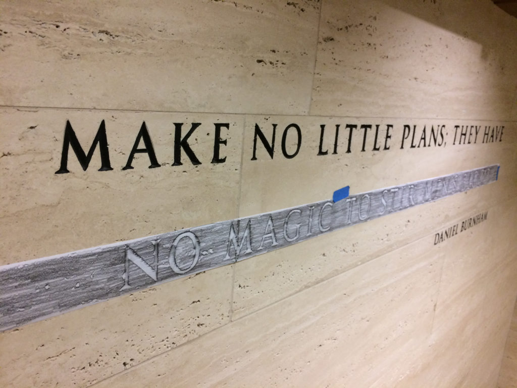 Pencil rubbing of Daniel Burnham's quote in the Tribune Tower lobby