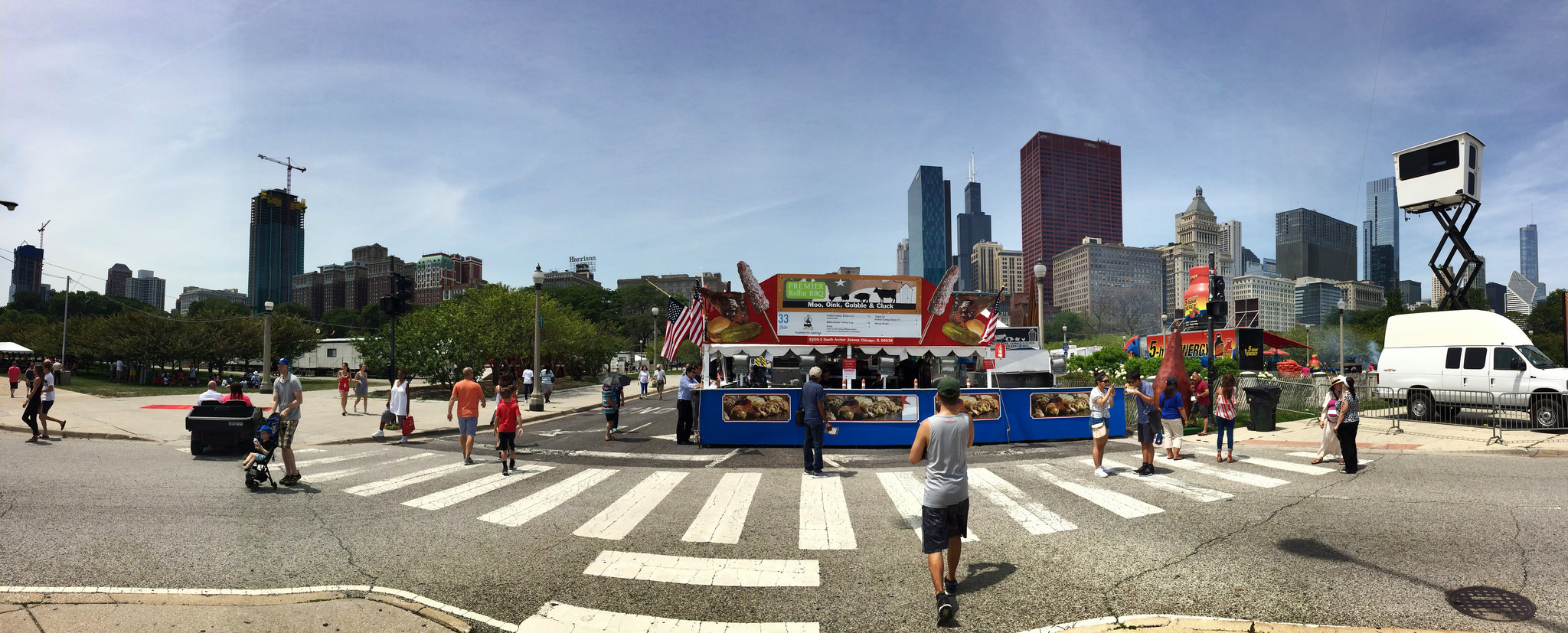 Premier Rollin BBQ booth at Taste of Chicago, offering turkey leg