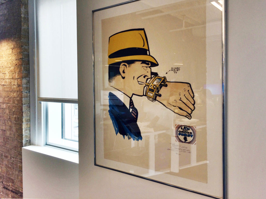 Original Dick Tracy artwork hanging on the walls in the Tribune Content Agency office