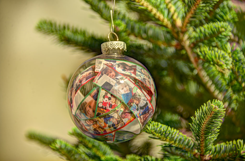 Photo strips inside clear plastic ball ornament