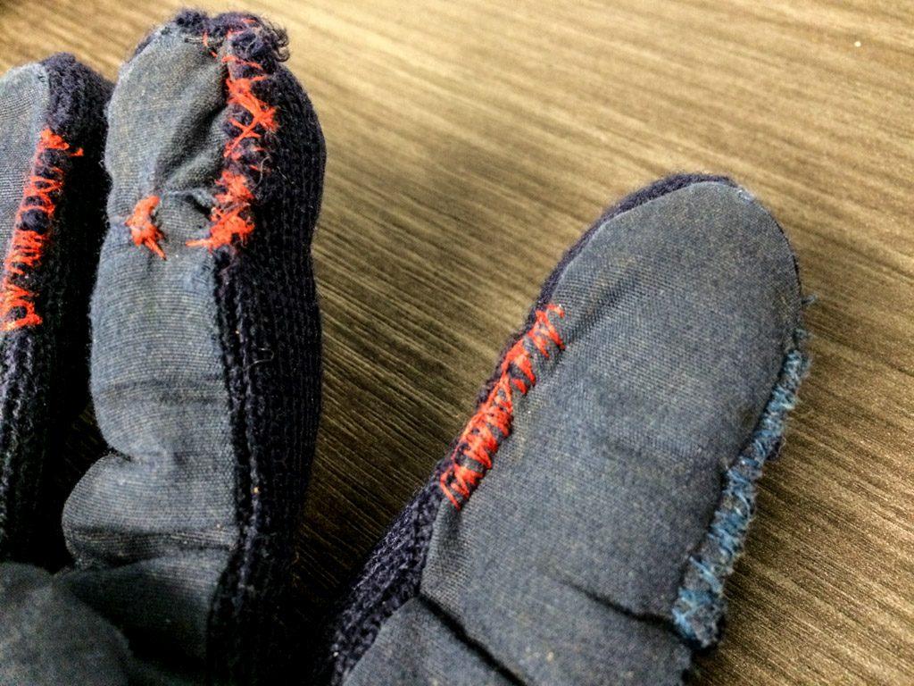 Kintsugi sewing repair on gloves