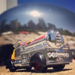 A fun pair: a reflective tanker truck by the shiny Chicago Bean