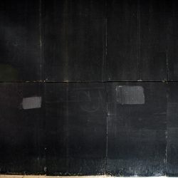 Painted black boards at 110 N Wacker construction site in downtown Chicago