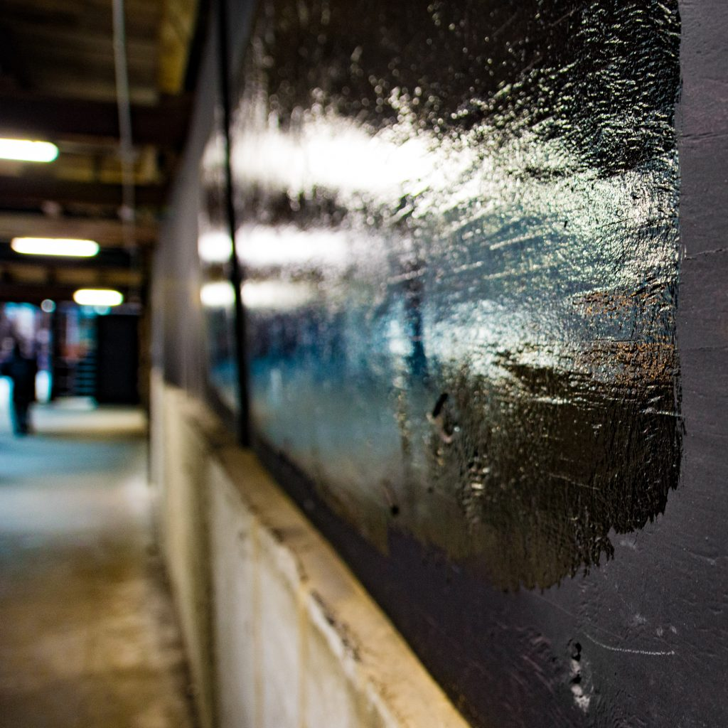 Black glossy paint on construction boards at 110 N Wacker, Chica
