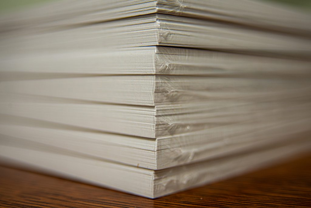 Stack of shrink-wrapped Christmas cards