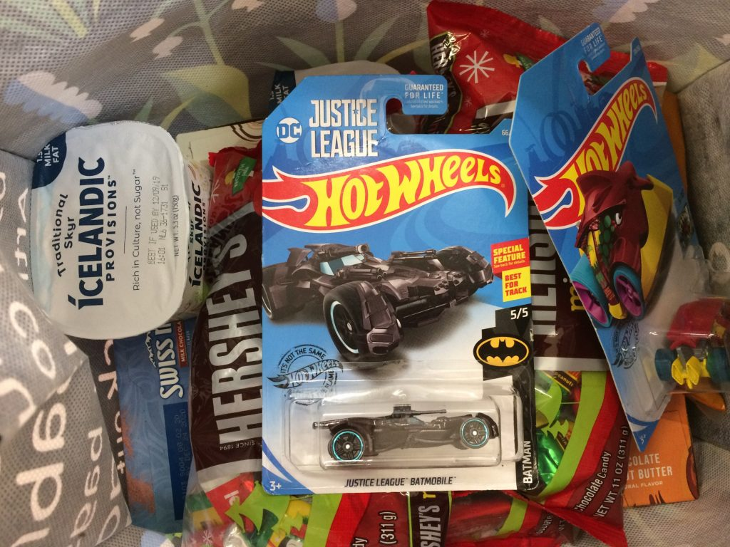 Regular contents of my shopping bag: Hot Wheels, yogurt, and chocolate