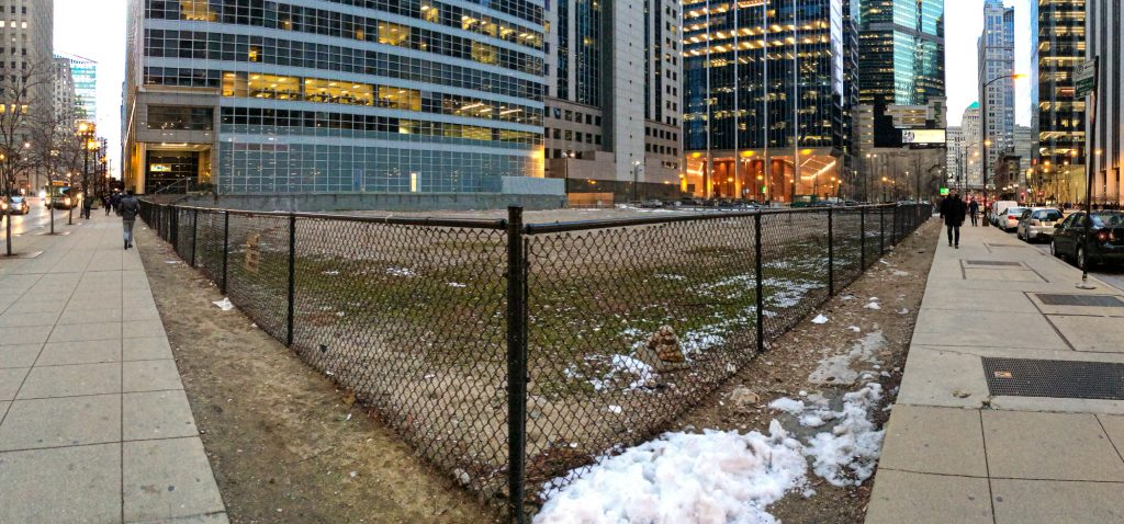 130 North Franklin fenced empty lot at Franklin and Washington, Chicago
