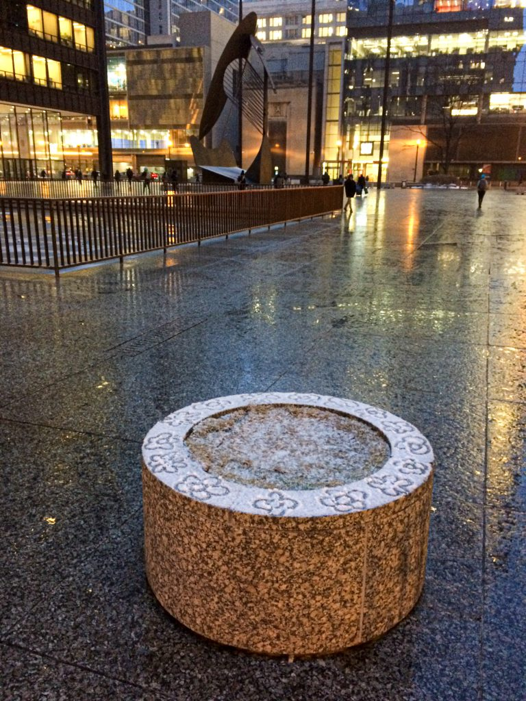 Busy city, quiet planter with finger-drawn snow graffiti