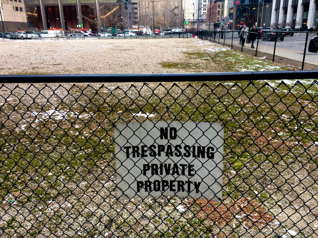 "Sign that says ""No tresspassing private property"" at the empty lot of 130 North Franklin, Chicago"