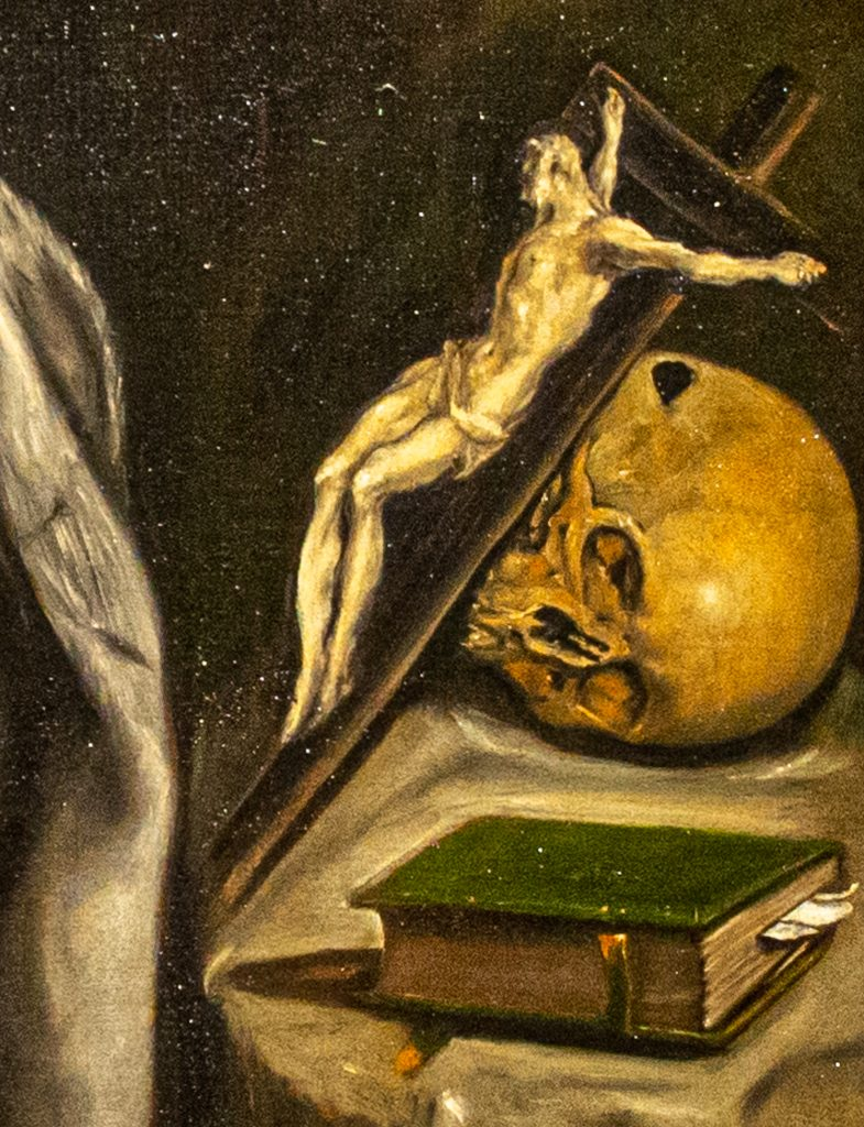 """Detail of skull, crucifix, and devotion book in """"Saint Francis Kneeling in Meditation"""" by El Greco"""