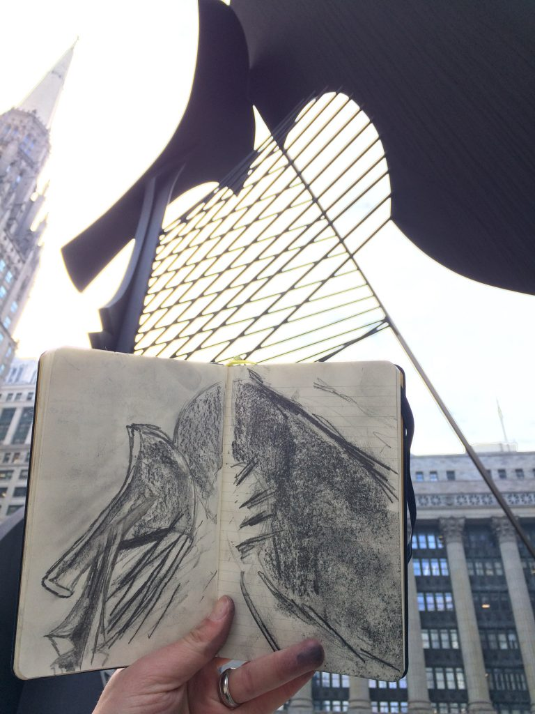 Holding up the drawing of the Picasso against the silhouette of