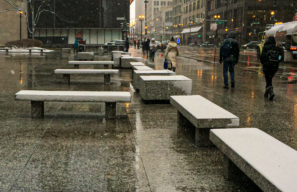 Snow-covered benches in Chicago's Daley Plaza
