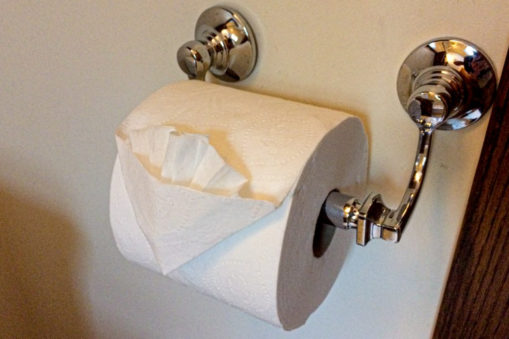 Toilet paper folded into fancy origami