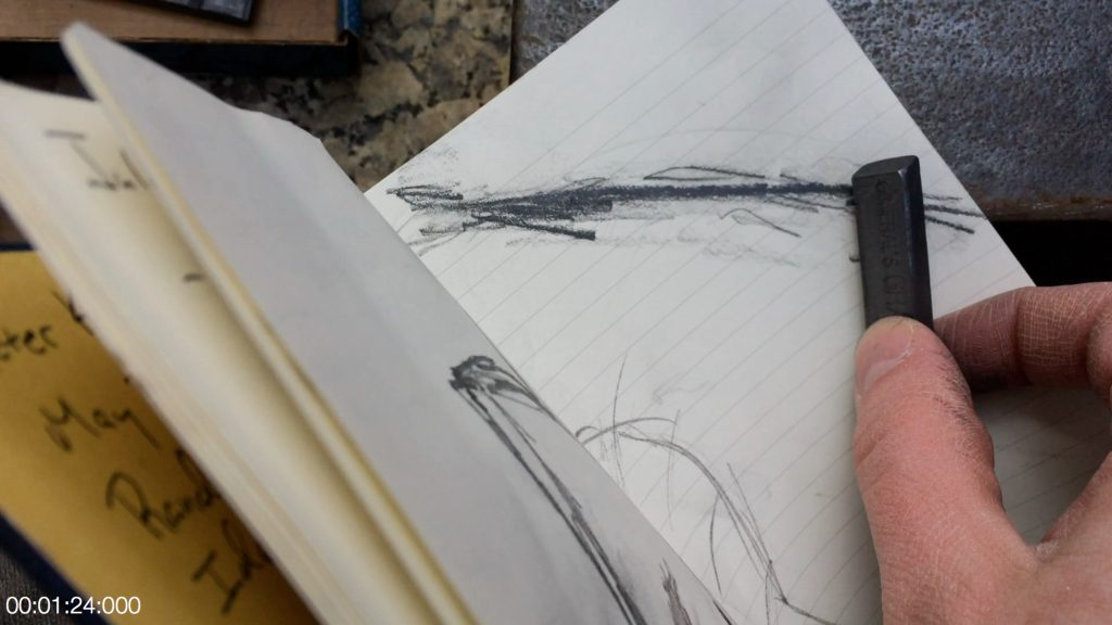 Use the edge of the Picasso to rub a line with graphite