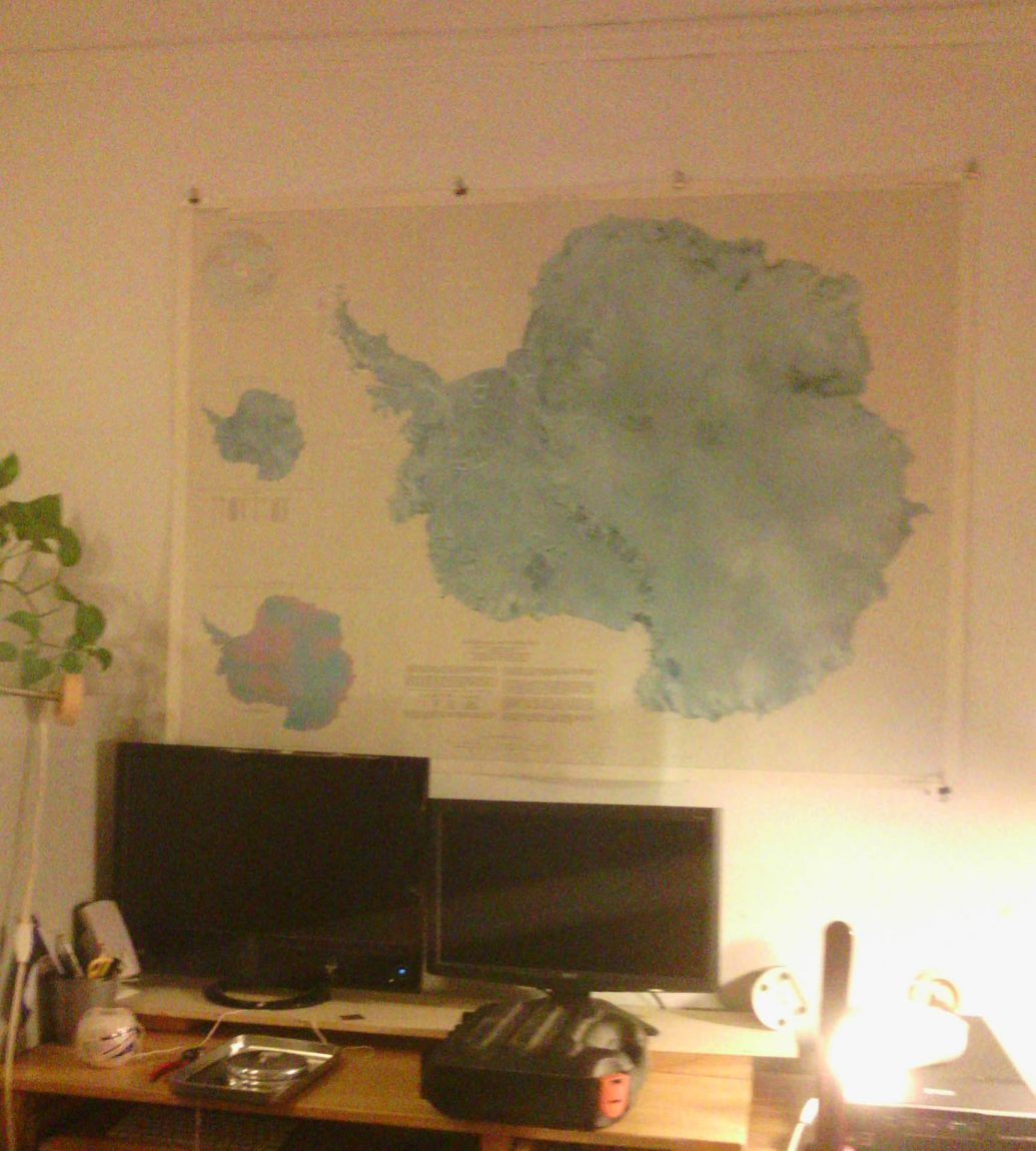 Poster above desk: SATELLITE IMAGE MAP OF ANTARCTICA