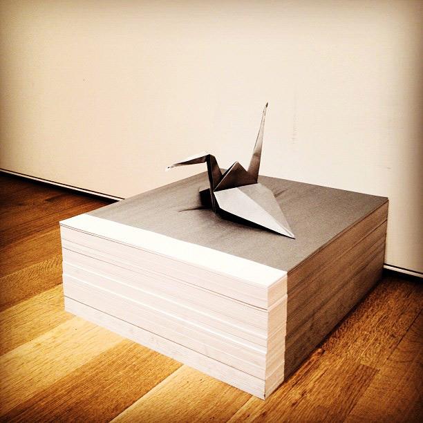 """Origami crane atop paper stack"" collaboration Félix González-Torres & Matt Maldre"