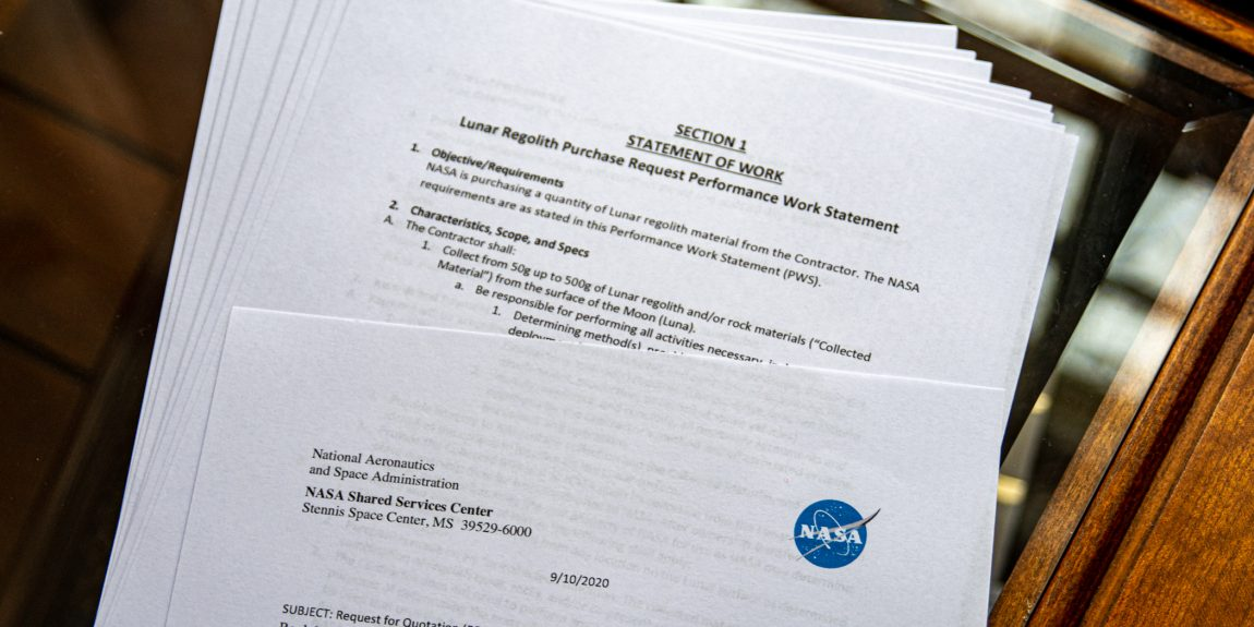 """Photograph of printed PDF """"Lunar Regolith Purchase Request Performance Work Statement"""""""