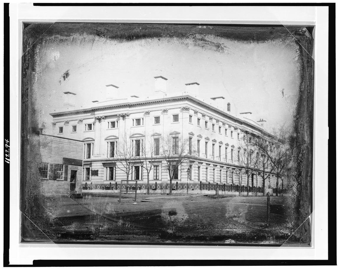 General Post Office from the corner of 8th Street and E Street, NW, Washington, D.C., the shop of Elija Dyer, merchant tailor, on the left