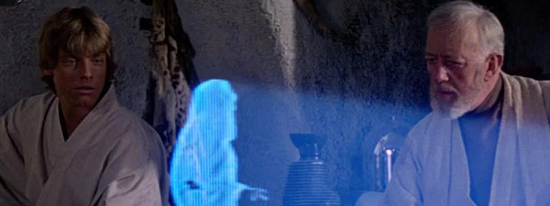 Luke and Obi-Wan watch Princess Leia hologram