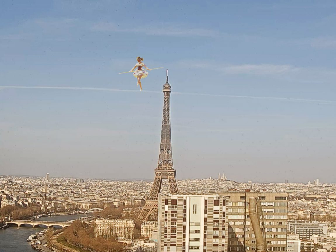 Tightrope walker photoshopped onto cloud by Eiffel Tower