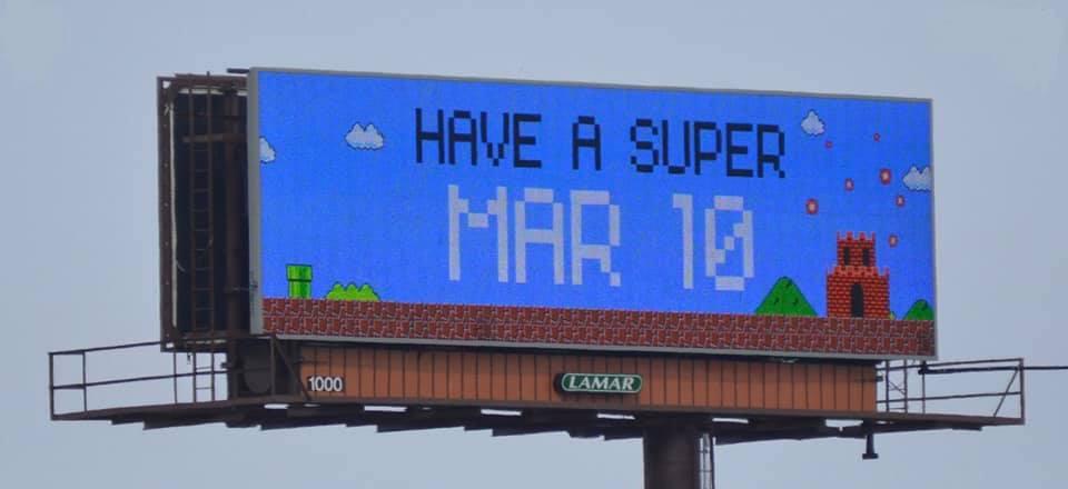 "Billboard saying ""HAVE A SUPER MAR 10"""