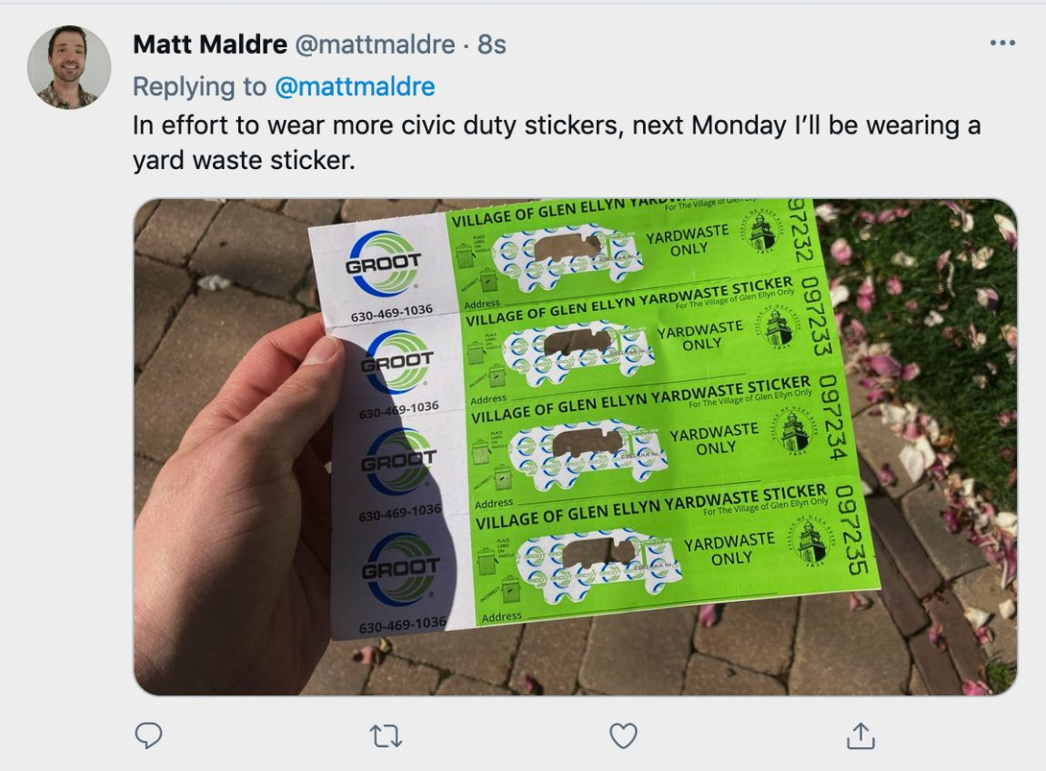 """Photo of me holding yard waste stickers. Tweet text says, """"In effort to wear more civic duty stickers, next Monday I'll be wearing a yard waste sticker."""""""