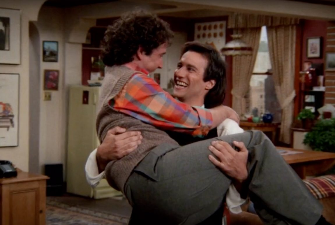 """Balki Bartokomous in Larry Appleton's arms after doing the """"Dance of Joy"""" on the tv show """"Perfect Strangers"""""""